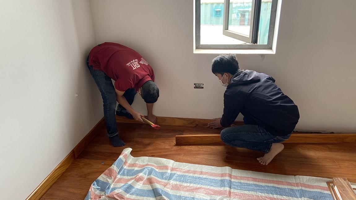 Thi công sàn gỗ gõ đỏ